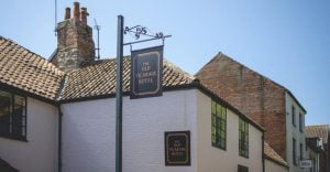 The Old Vicarage Hotel Outside front sign Gardens Web Resolution IMPACT 20twenty 2 1024x532 1